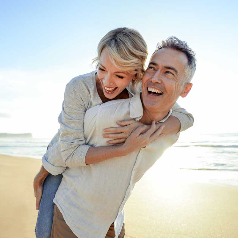 Happy couple enjoying life with hearing aids